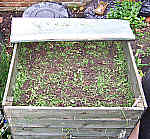 Timber bin composting weeds